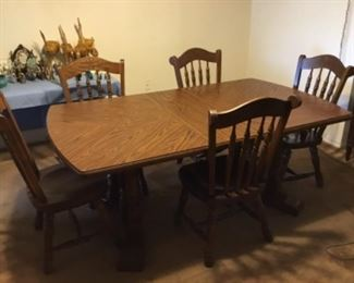 Table with leaf. It comes with five chairs and one captain chair.