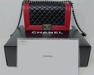 """452 Chanel Limited Edition Black/Red Leather Ruthenium Le Boy Medium Flap Bag with Box and Card Guaranteed AUTHENTIC!!!!!  In GREAT Condition!!  Gorgeous Limited Edition Chanel Le Boy Medium Two-Tone Le Boy Flap Bag in the MOST WANTED original medium size. Red and black leather with ruthenium hardware. SO rare! In excellent condition,. Comes with Chanel dust bag, Chanel box, and booklet.  10"""" x 6"""" x 3"""" (handle drop 11"""" - 20.5"""")"""