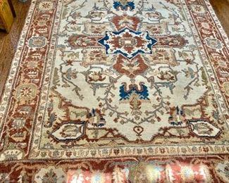 "$1,200 - Hand woven Serapi rug - 110"" L x 73"" W."