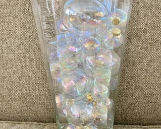 """$60 - Glass container: 12"""" H, 7.5"""" D filled with glass globes range from 1.5"""" diam to 3.5"""" diam."""