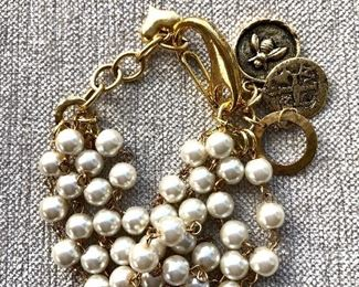 """$20 Faux pearl bracelet with charms at clasp area.  10""""L adjustable"""