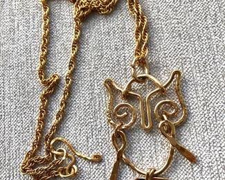 "$25 Owl gold-tone necklace.  15""L"