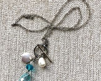 """$20 Silver-tone necklace with dangle pendant at clasp.  18""""L"""