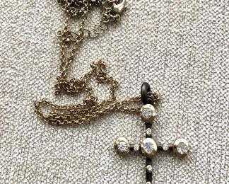 "$15 Cross pendant (32""L; cross: 2'L; 1.4""W) with white rhinestones on-chain."