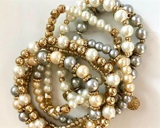 """$20  Set of 6 stretchy faux pearl bracelets.  2.5""""L adustable"""