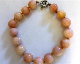 "$20 Orange color stone bracelet individually knotted. 8""L"