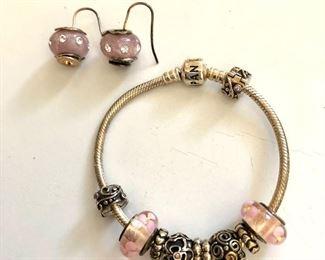 "$60 Pandora bracelet (2.5""L), $40 Cedora earrings sterling Italy (1""L)"