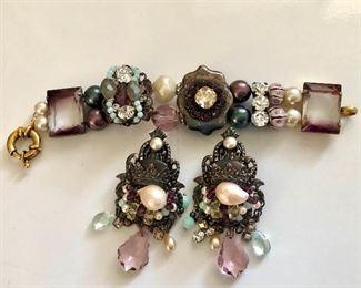 "$60  Eminiscense  Bracelet and earrings set.  Earrings: 3""L; 1.4""W.  Bracelet: 7""L"