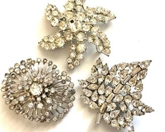 """$10 ea white rhinestone pins. Left pin SOLD  Star and leaf available. ~2.5""""diam each"""