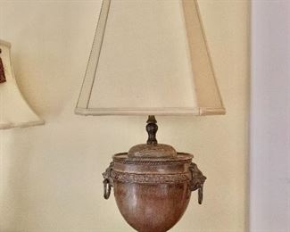 """$125- Metal urn lamp with lion accents.  26.5"""" H, base 9"""" wide  5.5 D."""