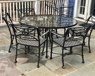 """$1,600 - Brown Jordan wrought iron glass top table and six """"weave"""" arm chairs"""