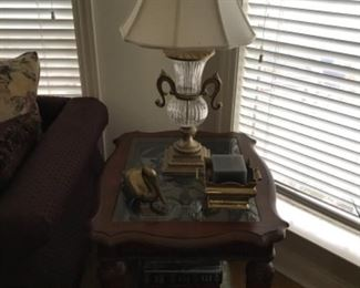 Side table with lower shelf and wrought iron insert under glass. $150.  One of two