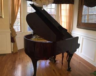 Beautiful Baby Grand Piano and Chandelier is for sale