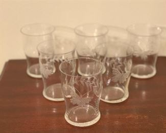 "Item #11 Set of 6 antique etched tumblers measuring 4"" H by 3"" W . The have a lovely butterfly and vine etched on each glass. one glass has a tiny flea bite on the rim. It is visible, but not sharp to the touch. $30 set of Six"