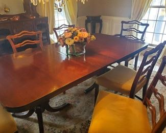 """Fabulous Mahogany Double Pedestal  Dining room table  With Six Chairs  - 65""""L x 42""""W  x  29 """"H.  Includes one leaf 12"""" with 4 side chairs &  2 arm chairs"""
