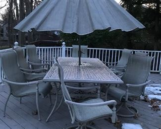 FORTUNOFF Ario Deck Furniture..... Includes Table,  Eight Chairs, Umbrella, Two Chaise Lounges, side table & covers.