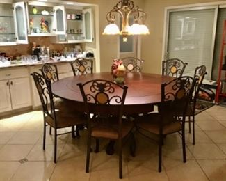 Beautiful Round Dining Table, Seats 8, Leaves fold and Store under Table for a smaller size