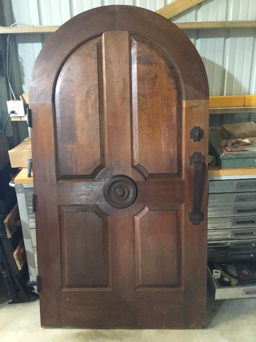"Spanish cedar round top entry door. Includes frame and all trim. Includes locking bolt w/key.  42"" wide x 77.5"" tall. 1 3/4"" thick."