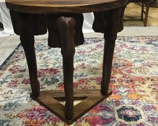 Teak wood table with elephant heads on corners