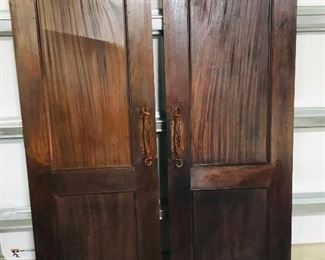 Double entrance doors with nice handles. Include double door frame. Believed to be mahogany.