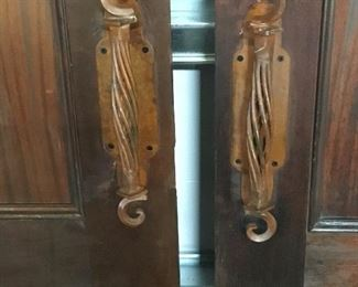 Ornate door handles.