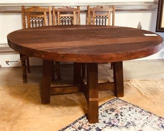 "Teakwood round table. 61"" wide. 31"" tall. 2.5"" thick."