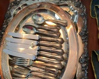 Silver flatware and sterling and silver plate trays.