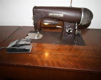 $85. Antique/vintage Kenmore electric sewing machine in cabinet.