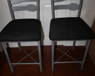 $90 pair. Two matching bar stools with knife, fork and spoon metal backs. Seats measure 24 inches high