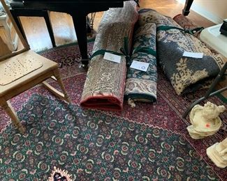 Various  sizes and colors of oriental rugs.