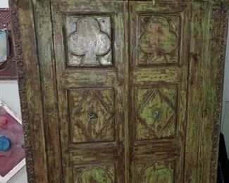 400 year old doorway turned into a teak cabinet.