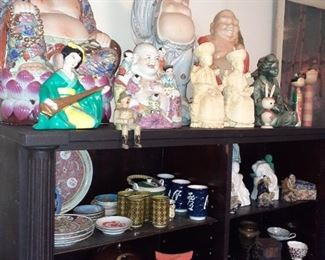 Buddhas and one of several shelves full of oriental goods