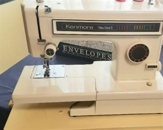 Kenmore sewing machine with attachments