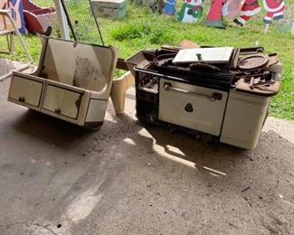 Antique Enamel Stove Needs quite a bit of work but has almost all the parts & pieces to it.  Bird nests are free! Must be able to move & load yourself. EXTREMELY HEAVY.