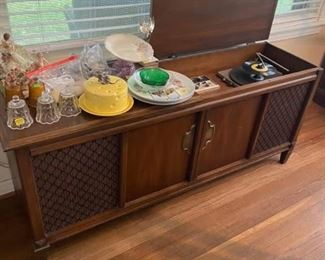 """Vintage Record Player / Radio Cabinet  Radio works!  You can hear the motor running on the record player but it will not spin. Has needle.  58"""" x 16"""" x 25"""" tall Must be able to move and load yourself."""