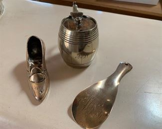 $45 3 1/2'' Antique English sterling shoe with monogram (probably a pin cushion originally);  $45 antique S/P mustard pot with monogram; $60 Antique English sterling shoe horn with Monogram