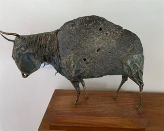 $295 Ernest Badynski (1934-2011) stone and copper bison sculpture 19'' x 12 1/2'', 13 1/4'' x 6'' wooden base