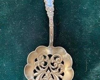 $20 pierced silver and delft spoon