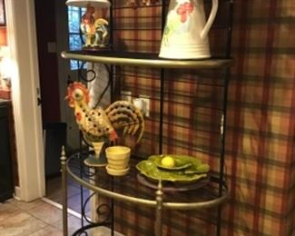 Black metal and brass baker's rack. Vietri pitcher, rooster lamp