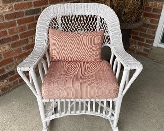(P-2) $50- White Wicker Rocking Chair w/ Pillows- 33inH x 30inW x 21inD- *Painted white, may need some touchup paint.  Cushions included