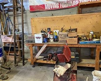 assortment of tools and ladders