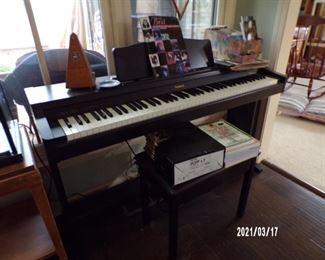electric piano, sheet music, metranome