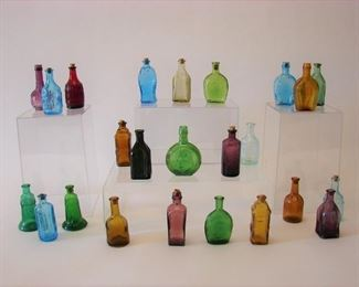 large lot of colorful antique tonic bottles
