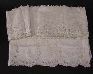 Lengths of deadstock openwork and embroidered flounce or dress fabric