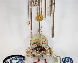 Large of of vintage costume jewelry including necklaces, bracelets, brooches, pins, clip on earrings