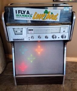 """Vintage Montgomery Ward Record Player. Super cool light up record player with AM/FM radio and tape deck. Some light wear as pictured, but in otherwise great vintage condition. Measures 22"""" wide, 15"""" deep and 32"""" high."""