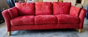 """Contemporary Red Sofa. Matches the previous lot, however this piece does have some significant sun fading on one side as pictured. Measures 86"""" wide, 31"""" deep, 17"""" high to the seat and 30"""" high to the sofa back."""