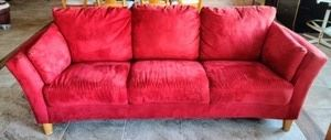 """Contemporary Red Sofa. Vibrant colored piece! There's a few light spots as pictured, but in otherwise great condition. Measures 86"""" wide, 31"""" deep, 17"""" high to the seat and 30"""" high to the sofa back."""