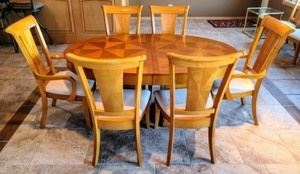 """Beautiful Dining Room Table. Fantastic table includes two additional leafs and eight chairs for extra seating! There are some light scratches on the table top and the chairs upholstery has some stains as pictured. There are no manufacturer markings.  Measurements:  Table(as pictured): 43.5"""" x 67.5"""" and 30"""" high. Each leaf measures 12"""" wide.  Chairs: 22"""" wide, 19"""" deep, 17"""" high to the seat and 41"""" high to the chair back."""
