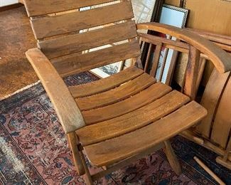 Lot  17: $200- Set of 4 folding wooden chairs from Germany.  This one has longer arms than others